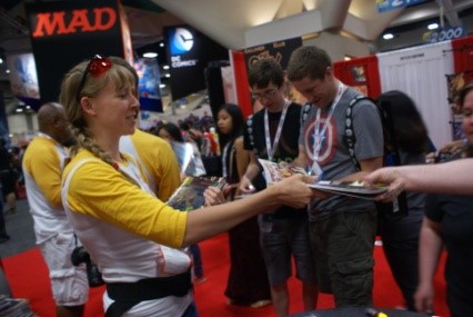Spectra author Beck Thompson handing out comic books at Comic-Con International 2013
